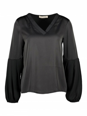 Inaya blouse logo
